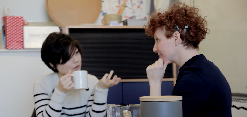 Two people having an artist support session over a hot drink.