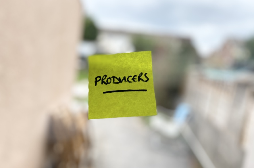 """A post-it note that says """"Producers"""", stuck to the window."""